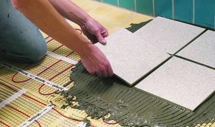 Теплый электрический пол под плитку: монтаж и особенности